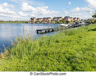 Waterside family homes in green residential Almere,...