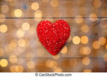 close up of red heart decoration on wood - love, romance,...