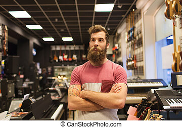 assistant or customer with beard at music store - music,...