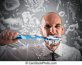 Big toothbrush - Man brushing teeth with a big toothbrush