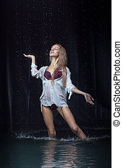 Woman under the rain - Pretty blonde woman under the water...