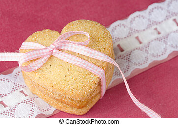 Heart-shaped butter cookies with sugar. - Three shortbread,...