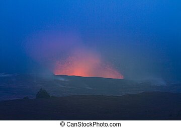 Erupting volcano - Beautiful glow from volcanic eruption at...