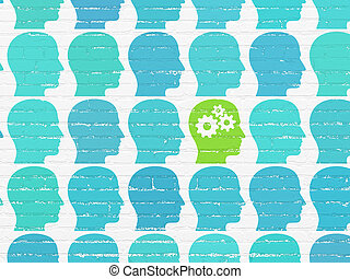 Learning concept: head with gears icon on wall background -...