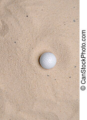 a golf ball in a sand trap