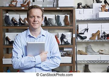 Man Running Online Shoe Business