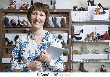 Woman Running Online Shoe Business