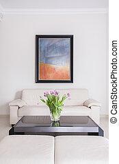 Cream sofa in sitting room - Cream sofa and black table in...