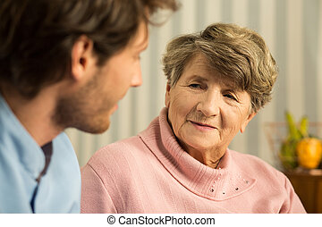 Positive elderly woman with carer