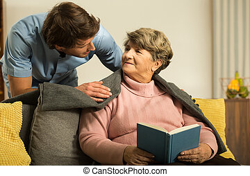 Private carer and his patient - Image of male private carer...