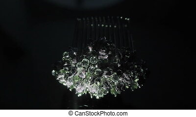 Jewelry shining in darkness Close up