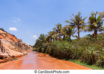 Tourists walk along the Fairy Stream (Suoi Tien), Red river...