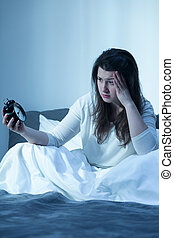 Problem with sleep - Tired young woman having problem with...