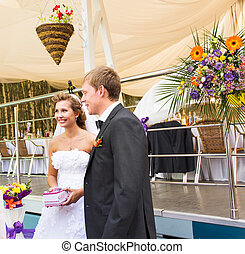 groom and bride at a wedding ceremony