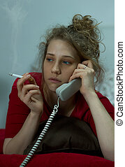 Tearful woman smoking and phoning - Image of a teraful woman...