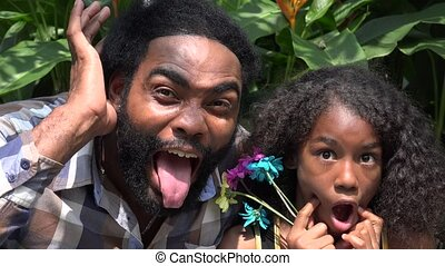 African Father and Daughter Acting Silly