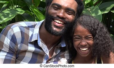 African Father and Daughter Laughing
