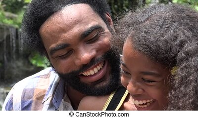 African Father and Daughter or Siblings