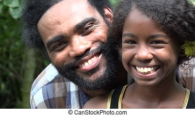African Father and Daughter