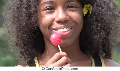 Teen African Girl with Lollipop