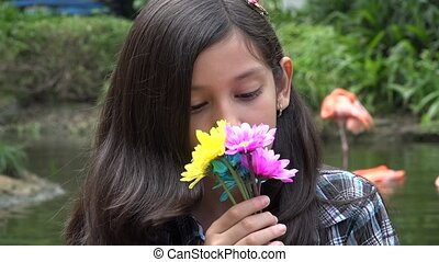 Hispanic Young Girl with Flowers