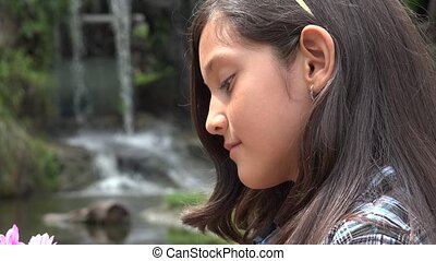 Smiling Hispanic Girl at Waterfall
