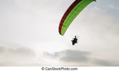 Paraglider in sky - Paraglider in the sky at sunset