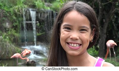 Hispanic Girl Near Waterfall