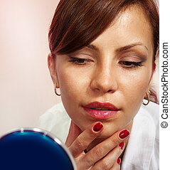 Lady with compact mirror