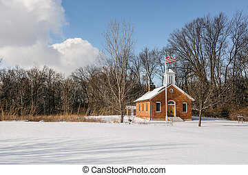 Snowy School House Scene - A snowy winter scene with an old...