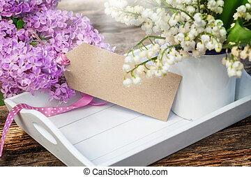 Greeting card with lilac and lily of the valley