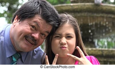 Father and Daughter Acting Silly