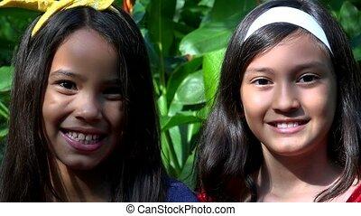 Young Hispanic Girl Friends