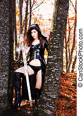 Cosplay - Woman with fantasy sexy dress and sword