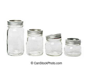 Four empty glass jar - Empty glass jar with metal lid with...