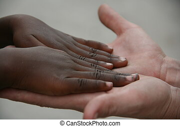Contrast - The hands of America helping Haiti