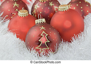 red baubles in white garland - closeup of red Christmas...