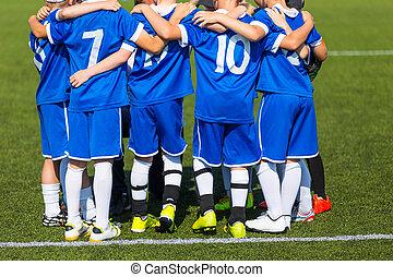 Soccer team; Boys With Football Coach - Coach giving...