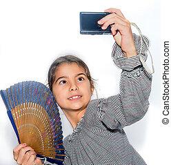 Cute little girl making selfie