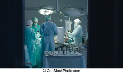 Nusres Assisting Surgeons During the Operation - There are...