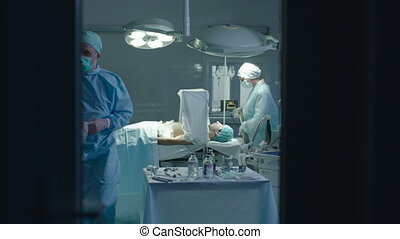 Operating Room after the Surgery - Medical staff is leaving...