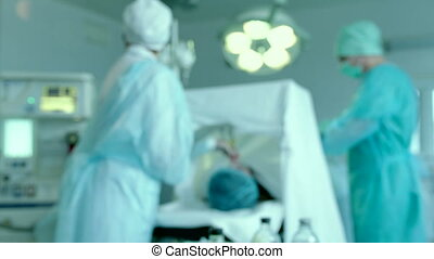 Medical Staff Working in Operating Room - Patient is lying...