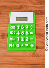 Calculator on table - Green rubber calculator on surface of...