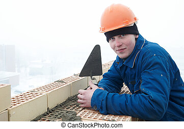 Brick layer worker builder mason - A brick layer worker...