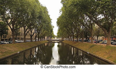 Water channel in Dusseldorf, Germany - A bright day The...