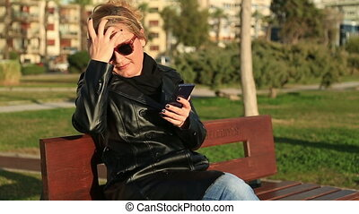 Woman using smart phone - Woman using a smart phone and...