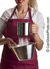 woman in an apron with a sieve