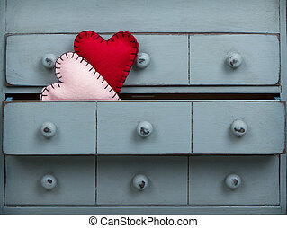 Two hearts inside a drawer in a dresser or chest