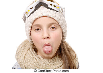 teenage girl sticking her tongue out isolated on white - a...