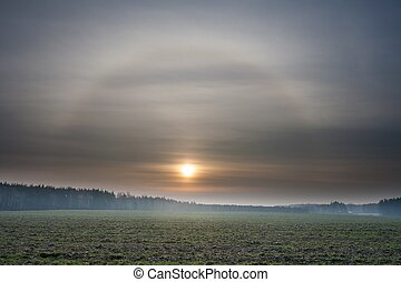 Sunset over meadow and halo effect - Beautiful landscape...